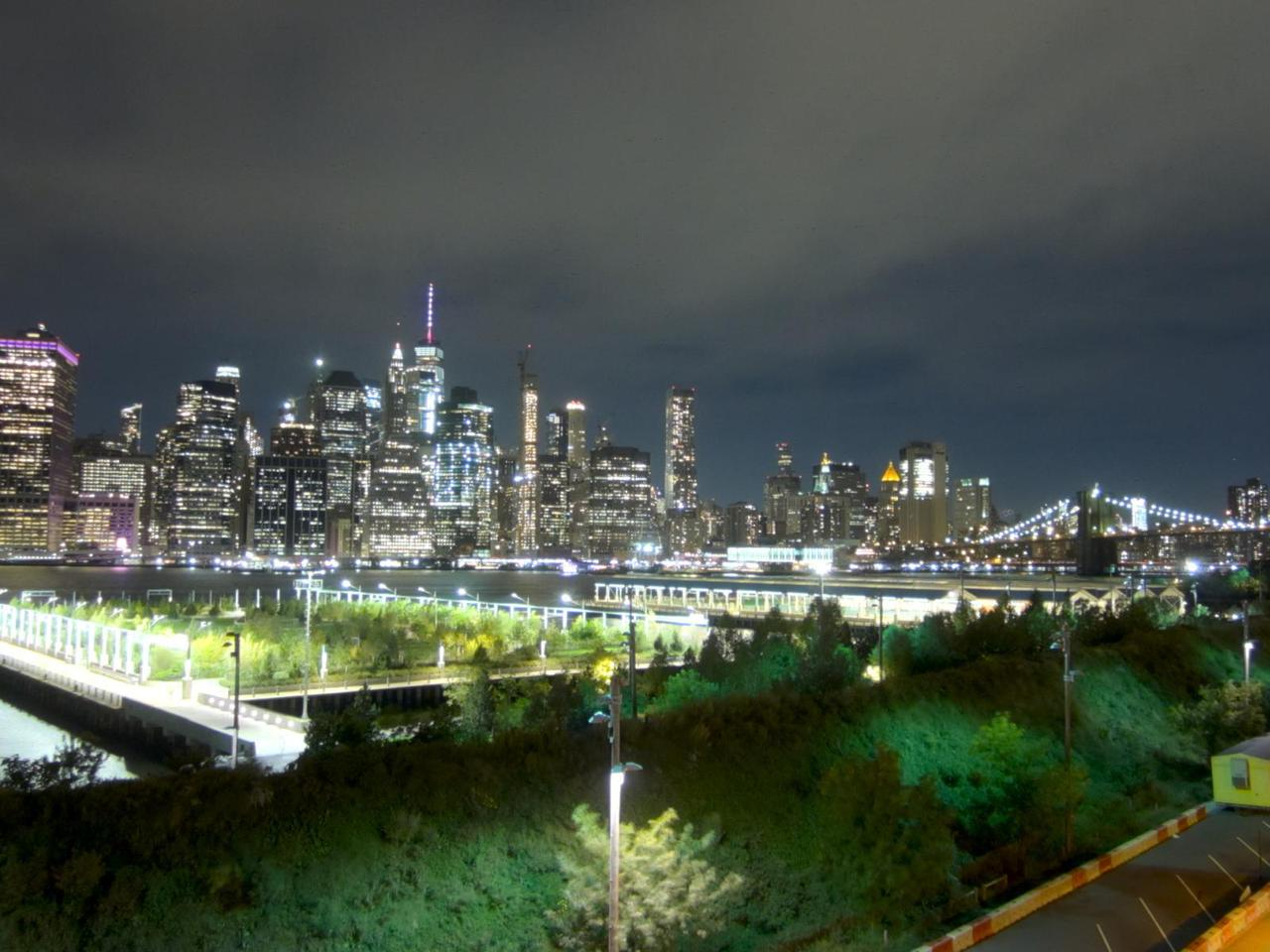 view of midtown manhattan at night from brooklyn
