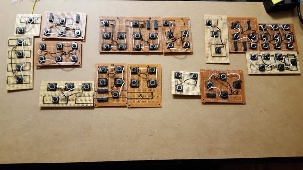 groups of circuitboards with buttons on them, connected with wires to other buttons in the same group.