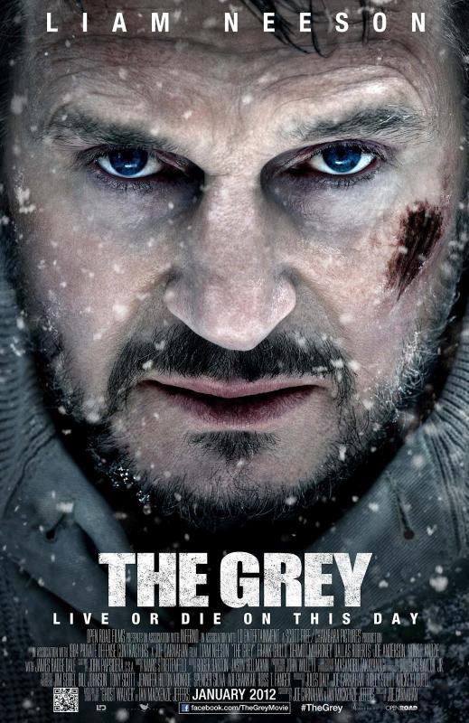 Movie poster for the movie The Grey. A close-up of Liam Neeson's face, which has a beard and several cuts on it.
